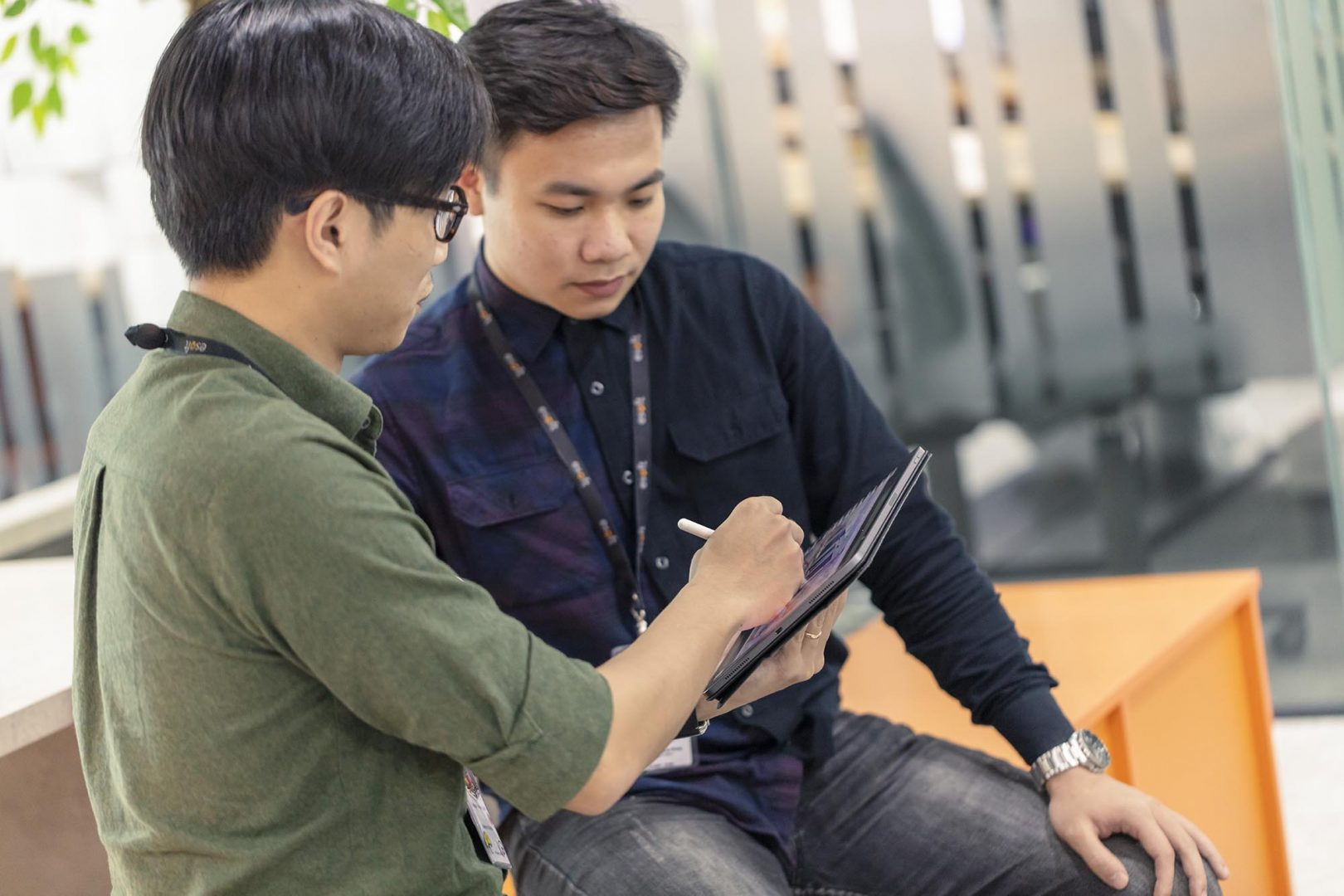 Employees at Esoft Vietnam with an ipad
